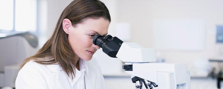 Scientist-looking-through-a-microscope.jpg